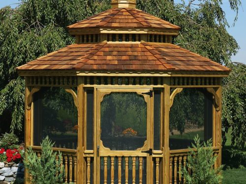 wood gazebo with screens sitting in front of large tree