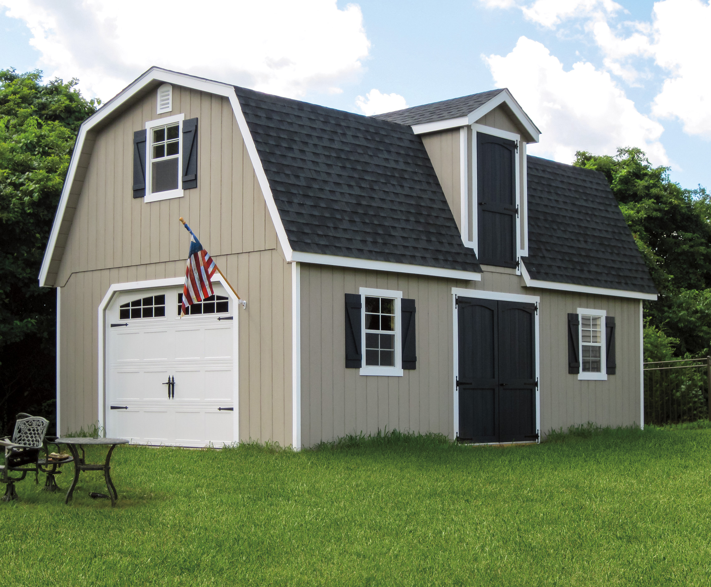 Two story tan wooden siding with gray shingles garage