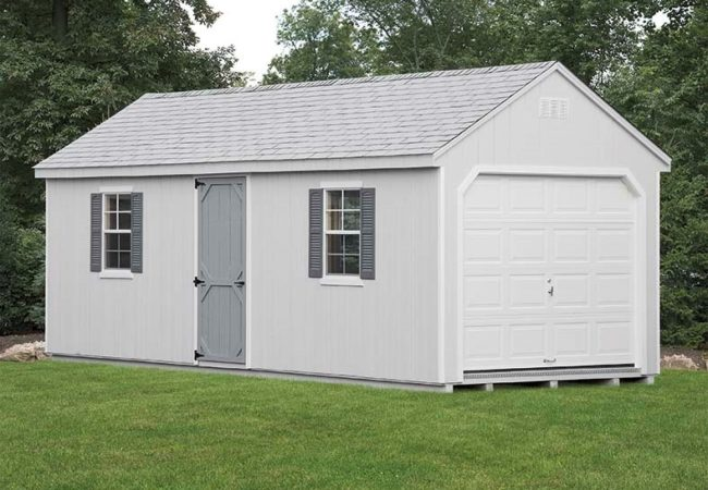 grey 7 cape amish built garage in backyard