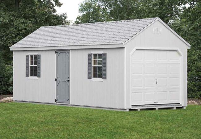grey 7 cape amish built garage in backyard