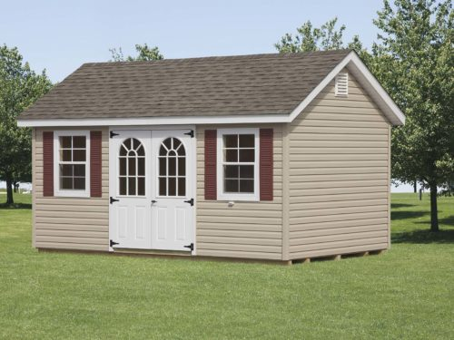 Tan classic cottage with white front doors
