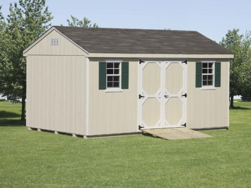 tan cottage shed with asphalt singles sitting on lawn