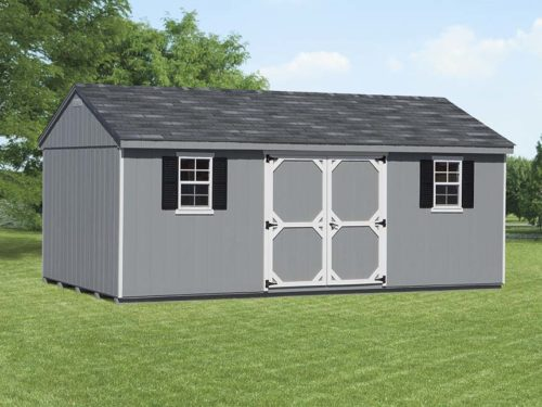 grey cottage shed sitting on lawn
