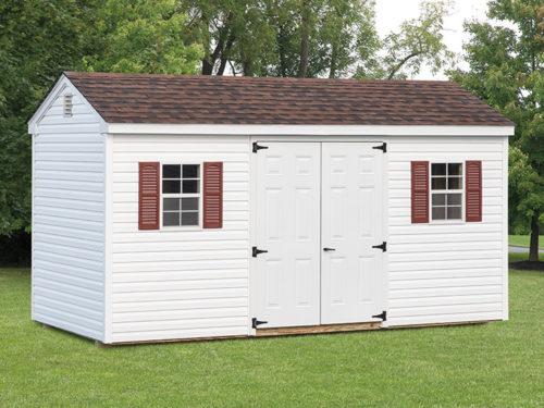 white cottage shed with white doors
