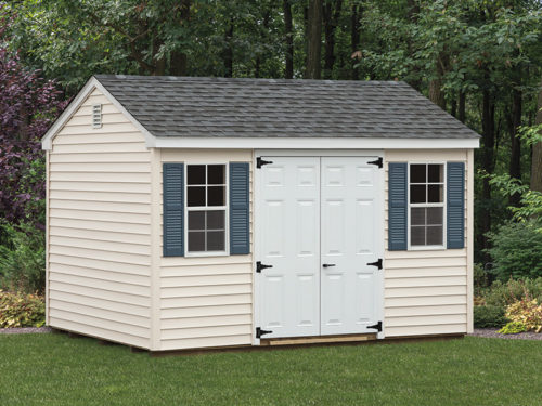tan cottage shed with white doors