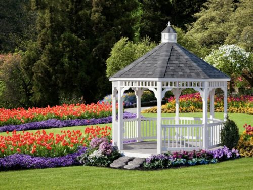 vinyl gazebo surrounded by flowers on a hill