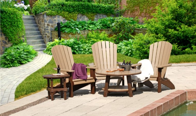 outdoor furniture sitting in front of pool