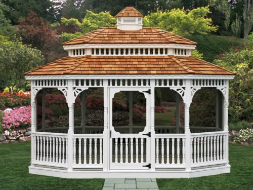 large vinyl gazebo sitting in front of flowers