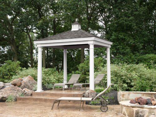 backyard vinyl pavilion sitting next to stone and bushes