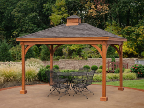backyard wood pavilion sitting over top outdoor furniture