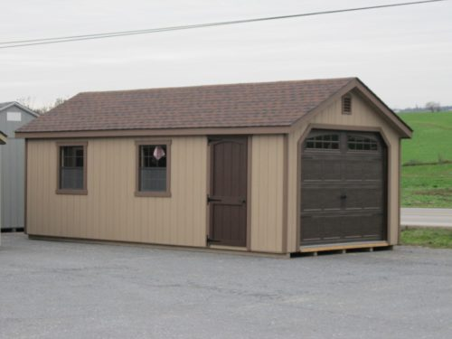 tan amish built classic cottage garage with brown doors