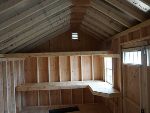 amish built classic quaker shed interior view of shelf and windows