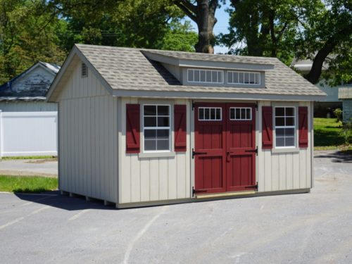 classic studio dormer shed with red doors