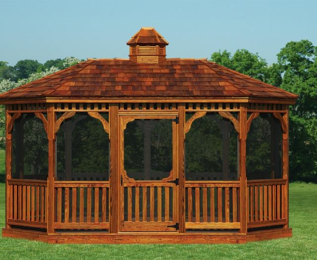 large amish built wood gazebo on grass in front of trees
