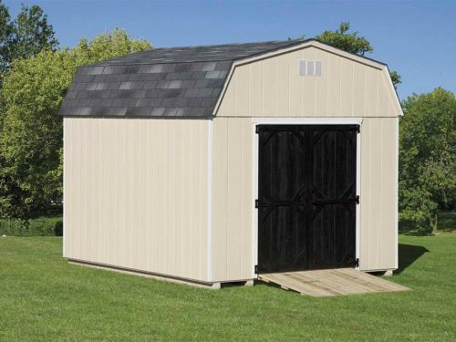 tan dutch barn shed with black doors