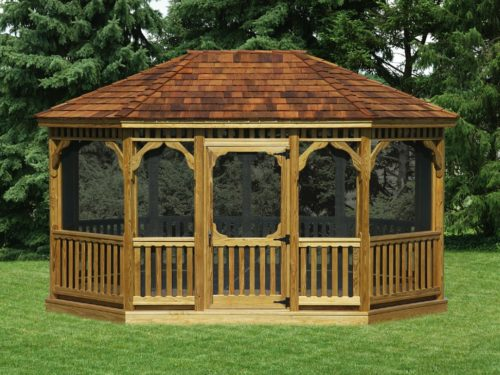 large wood gazebo sitting in front of pine trees