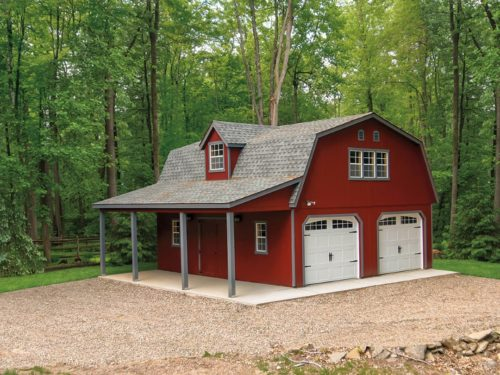 maroon two story dutch barn shed with two white garage doors