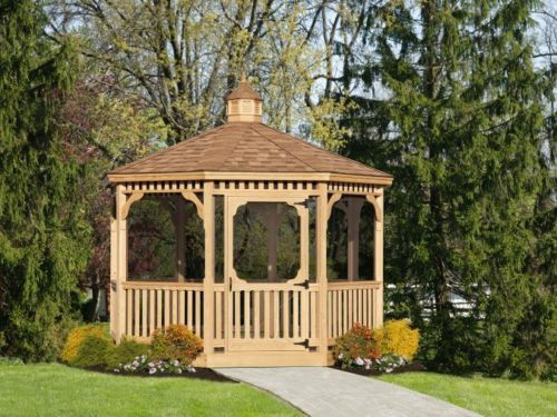 wood gazebo with stone path in front of trees