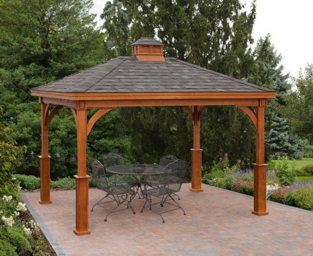 wood pavilion sitting on brick patio