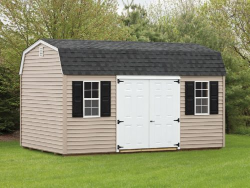 tan dutch barn shed with white double door