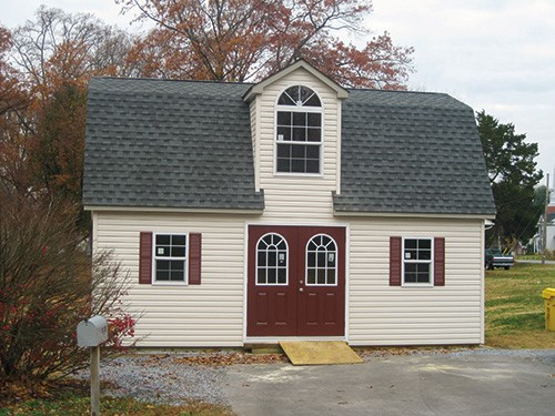 amish built two story dutch barn shed with double maroon doors