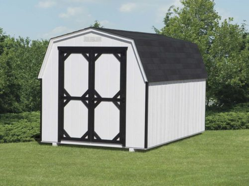 amish built white mini barn shed sitting on grass