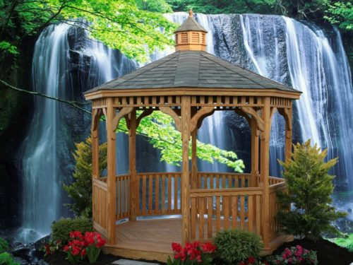 wood gazebo sitting in front of waterfall
