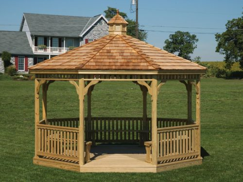 amish built wood gazebo sitting on lawn in front of house
