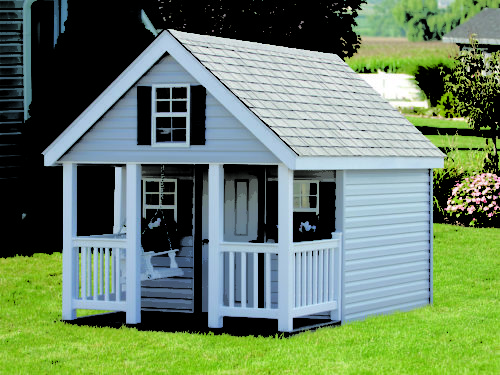 elite playhouse sitting in backyard
