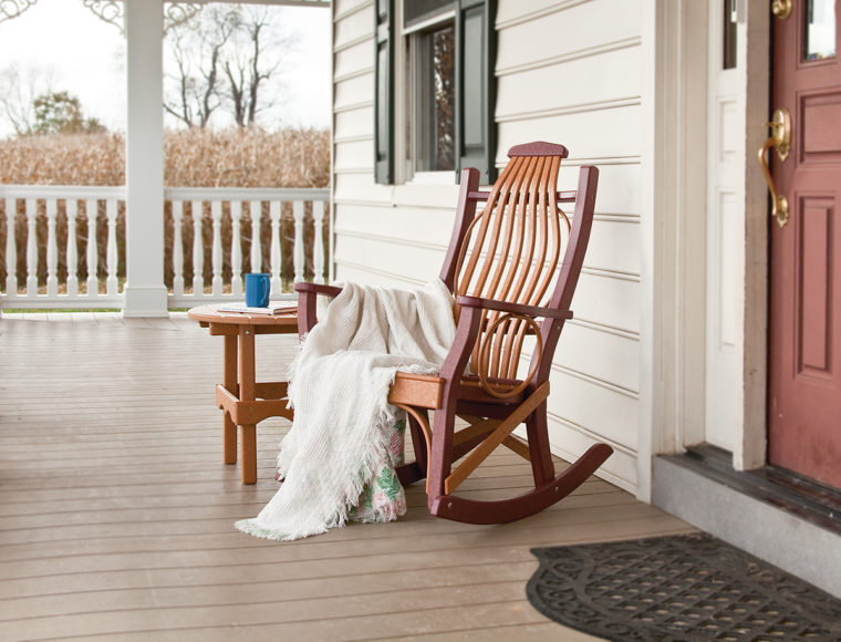 brown and maroon rocking chair and coffee table with white blanket