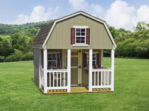 dutch playhouse in backyard in front of trees