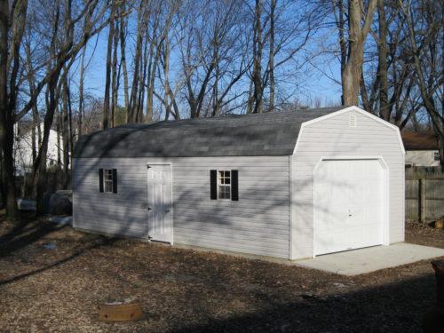 light grey storage garage with white garage door
