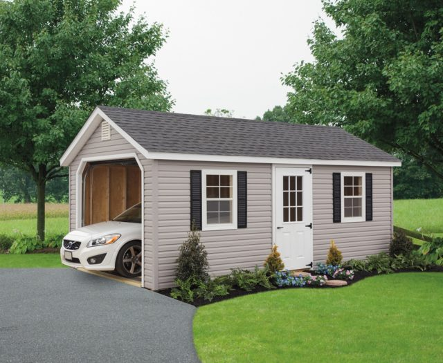 khaki classic cottage garage with white car inside