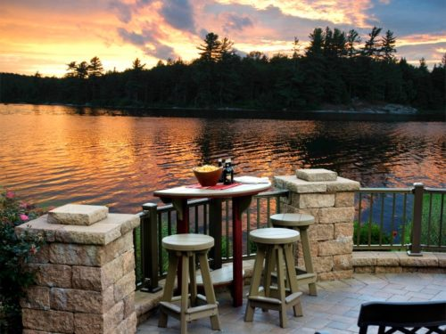 outdoor lawn furniture sitting next to lake in rural maryland