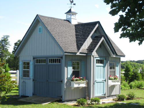 alpine shed with blue doors in backyard