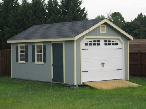 blue amish built classic cottage garage with white door