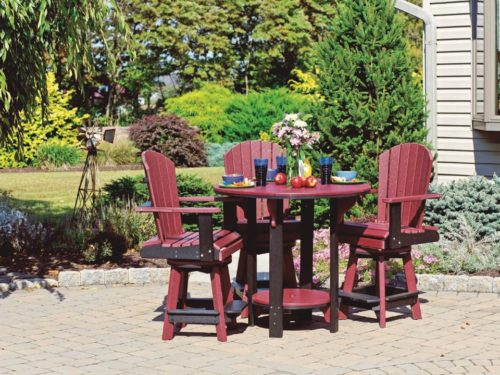 maroon and black outdoor lawn furniture set sitting on brick patio surrounded by plants