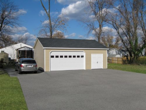tan two car garage with large white door