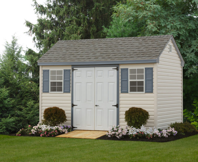 cape shed sitting in front of trees with flowers surrounding it