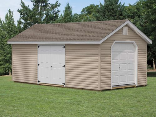 tan classic cottage garage with white doors