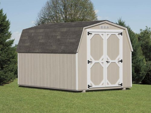 tan amish built mini barn shed sitting on lawn