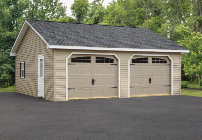 tan two car garage with tan garage door and white side door