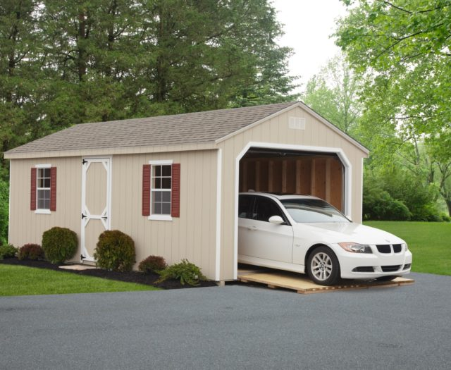 tan 7 cottage garage with white car inside