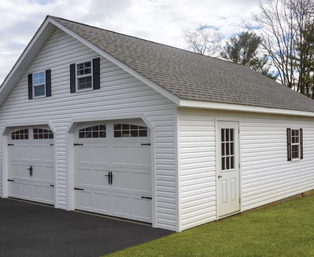 white two car garage with asphalt shingle roof