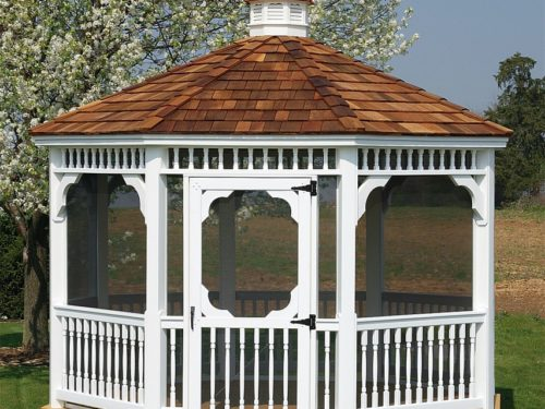 vinyl gazebo sitting in front of field