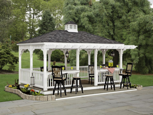 vinyl gazebo next to backyard patio