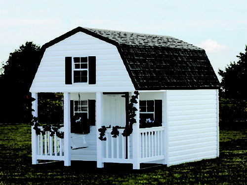 white outdoor playhouse sitting in backyard