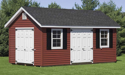 maroon man cave shed with white doors and shingle roof