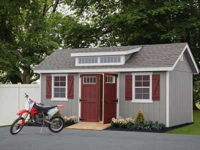 grey outdoor storage shed with red doors